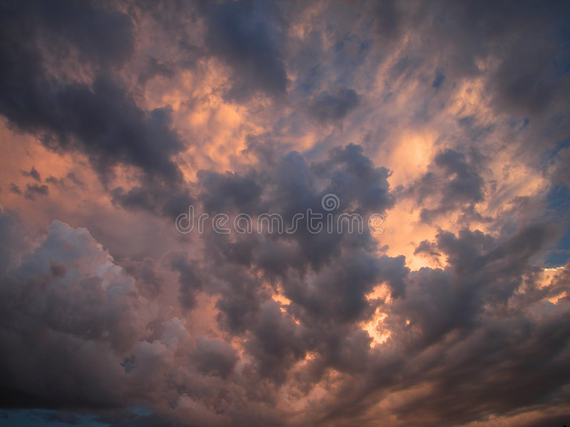Thundering Clouds. A stunning cloudscape at sunset or is it sunrise? It appears that the clouds are on fire stock photography