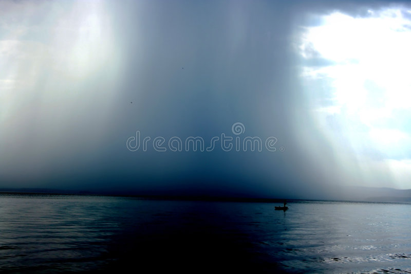 Thunderstorm cloudburst. The effective sky and lake stock photos