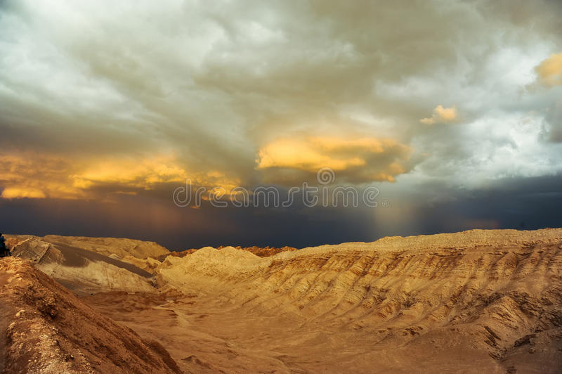 Thunderstorm developing over sand dune in Valle De La Luna in the Atacama Desert near San Pedro de Atacama, Chile stock images