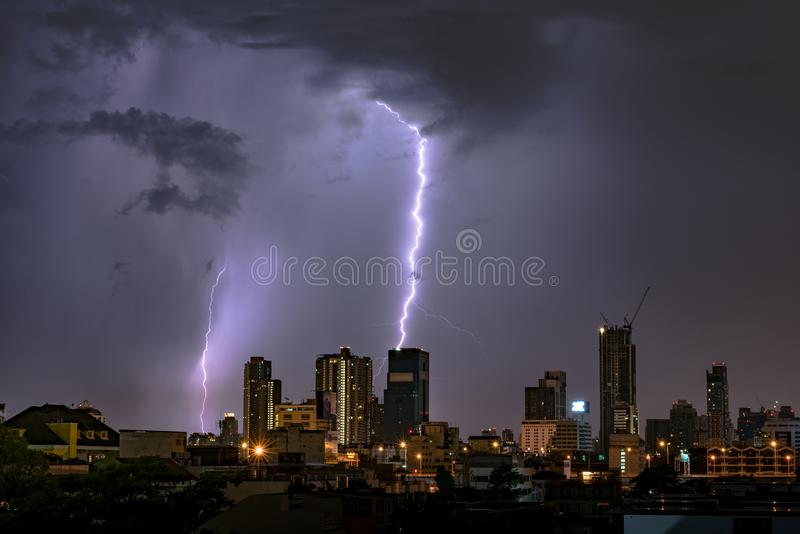 Thunderstorm Lightning Over City Skyline at Night. stock images