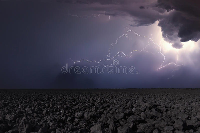 Thunderstorm with lightning in plowed field. Thunderstorm background stock images