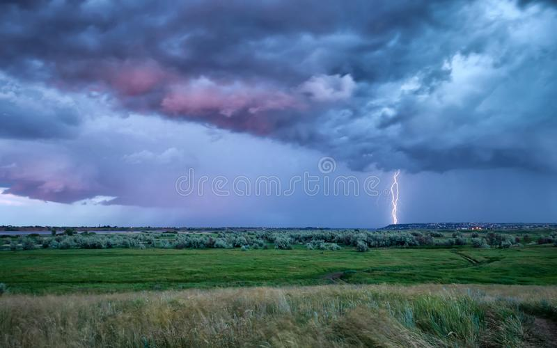 Thunderstorm and lightning at sunset of a summer day royalty free stock photo