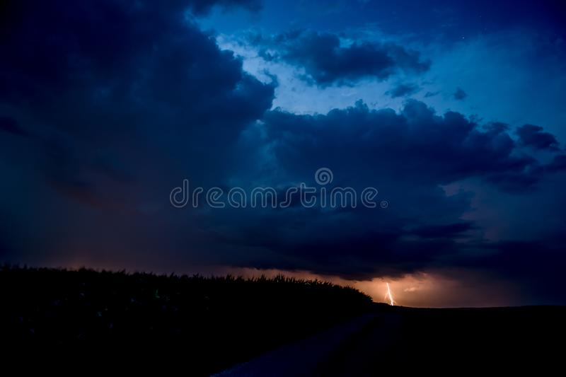 Thunderstorm with Lightning under Night-sky with Stars royalty free stock photos