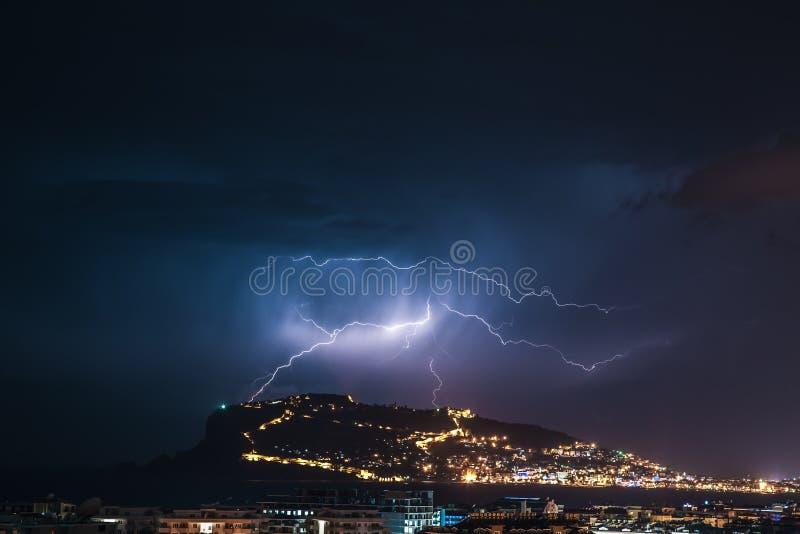 Thunderstorm over Alanya main peninsula. Toned royalty free stock photo