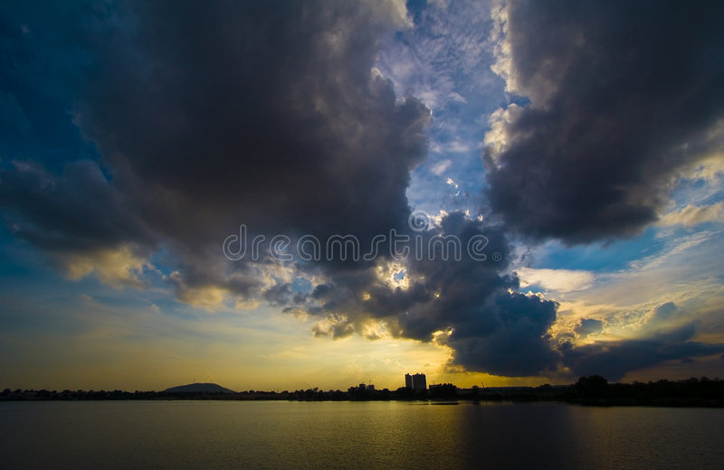 Thunderstorm and rain-clouds stock images
