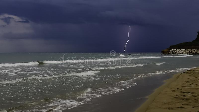 Thunderstorm on the sea at the southeast coast of Sicily stock photography