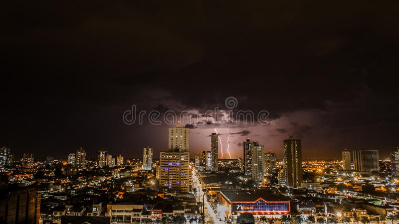 Thunderstorms Above City during Night Time royalty free stock images