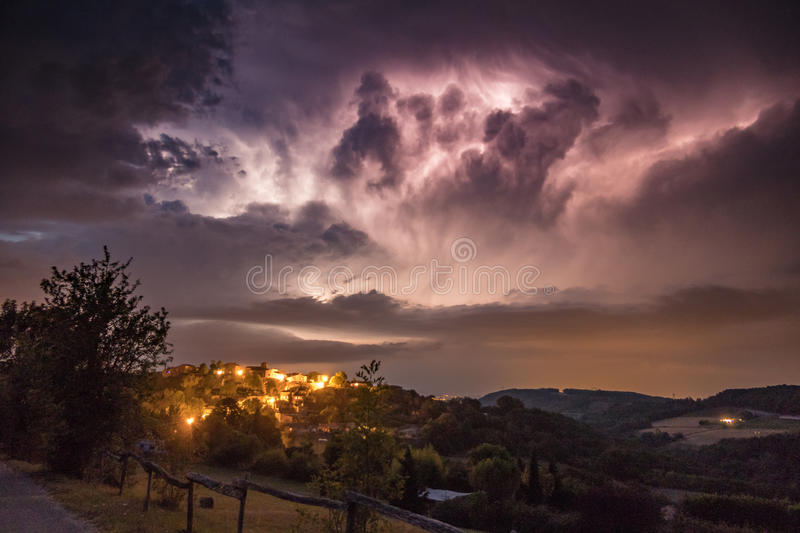 Thunterstorm with lightning above village at night royalty free stock photos