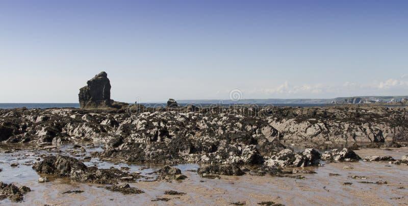 Thurlestone Rock at beach Devon. Thurlestone Rock Devon. Thurlestone Rock with tide out and rocks to the foreground royalty free stock photo