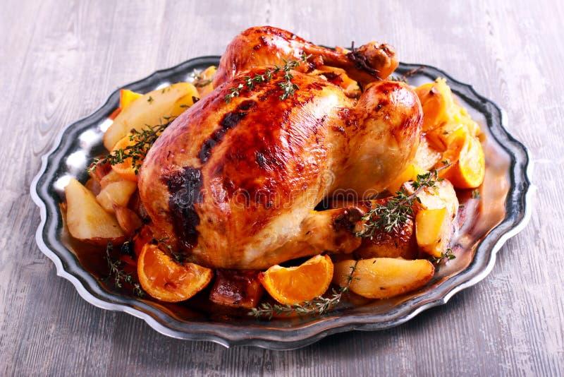 Thym et poulet rôti orange photographie stock