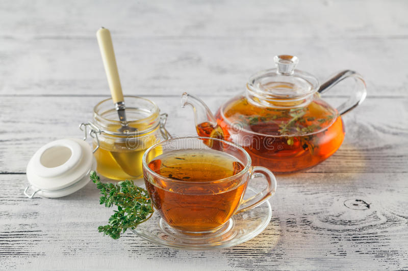 Thyme tea with fresh bunches thyme, thyme inside teacup, white b royalty free stock photo