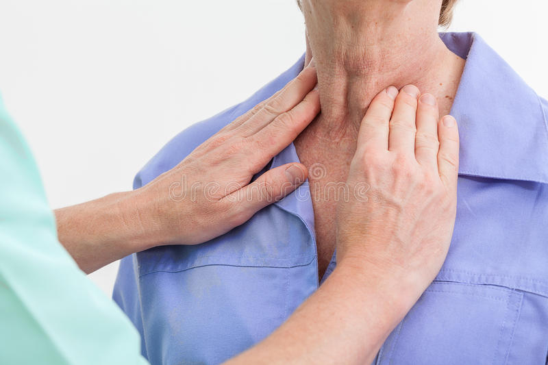 Thyroid problems. Problems with thyroid, nurse examining a patient royalty free stock image