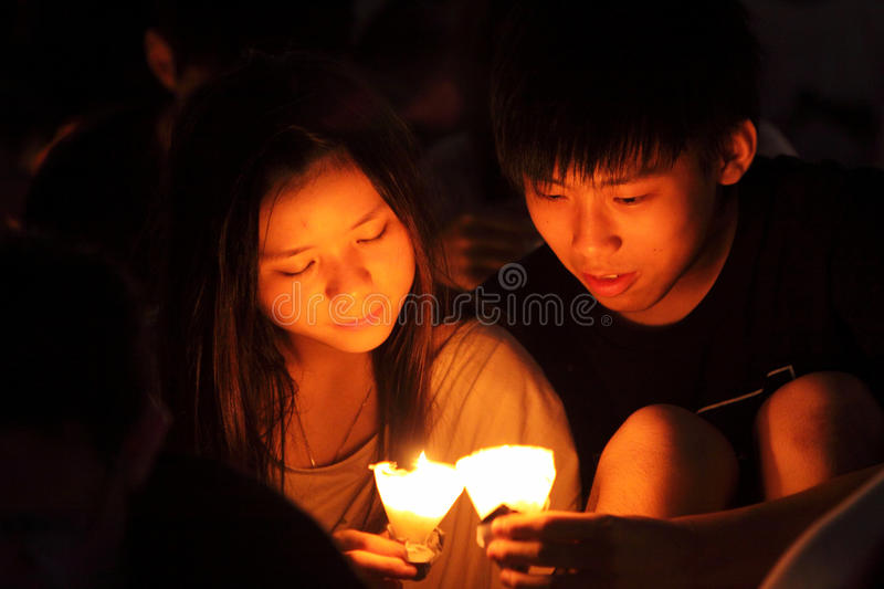 Tiananmen Vigil in Hong Kong. 150,000 people converged on Victoria Park to mark the 22nd anniversary of the bloody crackdown on pro-democracy protesters in stock photography