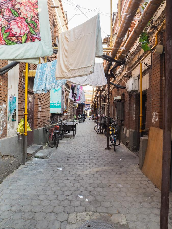Traditional old neighborhood in Tianjin French concession. Tianjin, China - September 2017: Traditional neighborhood with old houses and laundry hanging outside stock photos