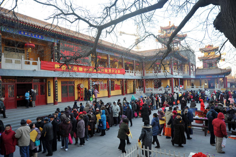 Tianjin jianfu guanyin temple. Outside the temples for citizens to distribute nearly 6000 laba rice porridge, so many people waiting in the cold, share the laba royalty free stock photos