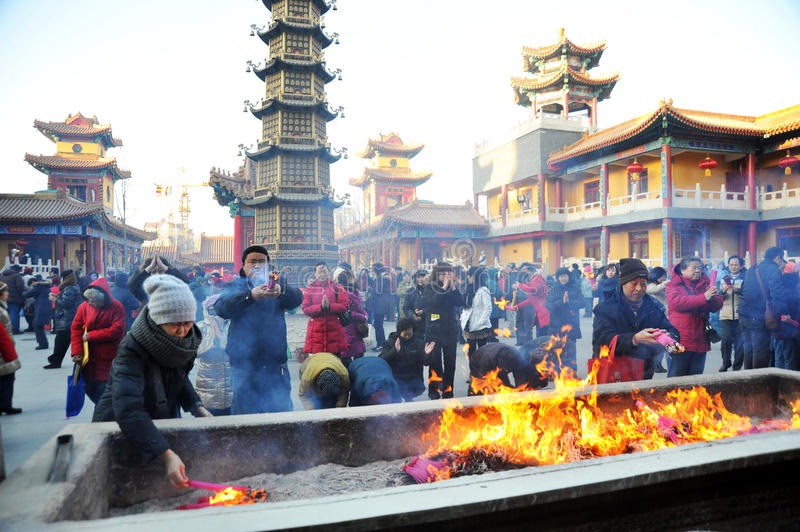 Tianjin jianfu guanyin temple. Outside the temples for citizens to distribute nearly 6000 laba rice porridge, so many people waiting in the cold, share the laba stock photos