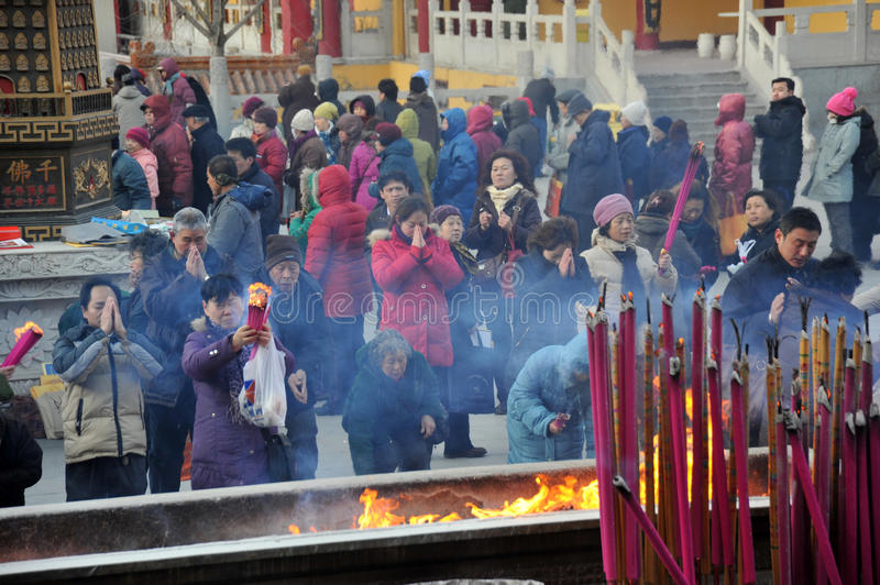 Tianjin jianfu guanyin temple. Outside the temples for citizens to distribute nearly 6000 laba rice porridge, so many people waiting in the cold, share the laba stock photo