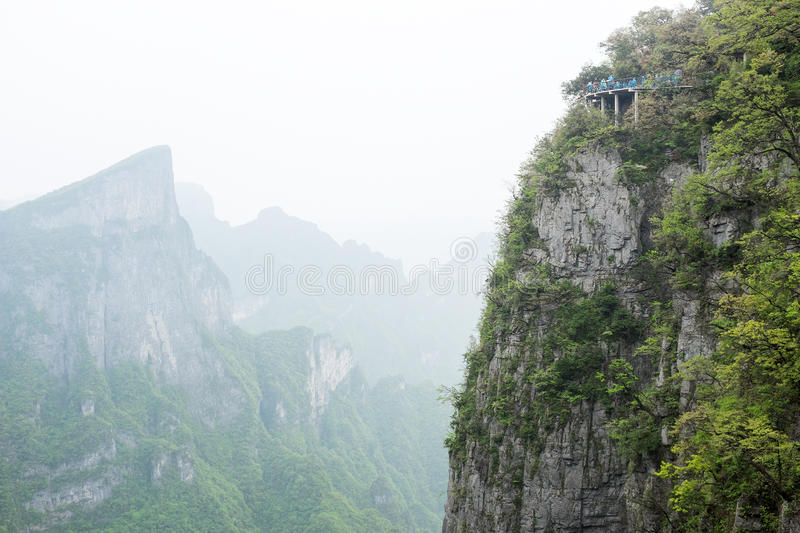 Tianmen mountain, China with scary footpath on a steep cliff. Tianmen mountain landscape in China with the famous and scary sightseeing footpath on a steep cliff stock images