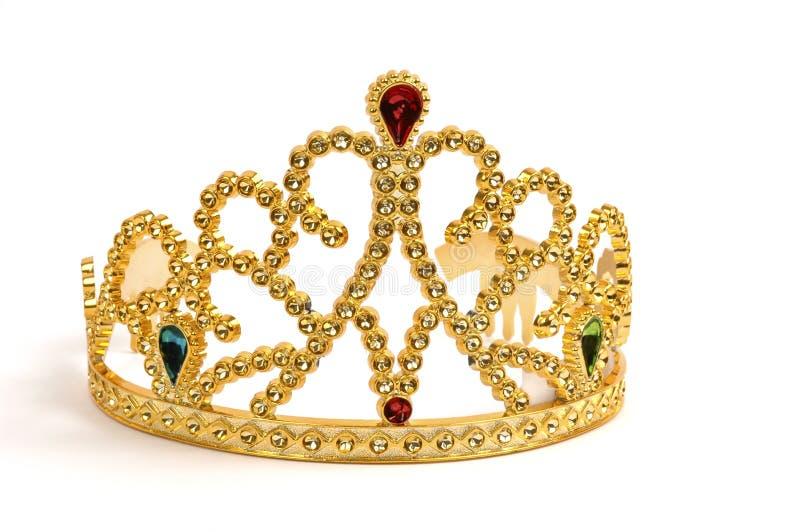 Tiara. Gold tiara studded with fake jewels and diamonds royalty free stock photo
