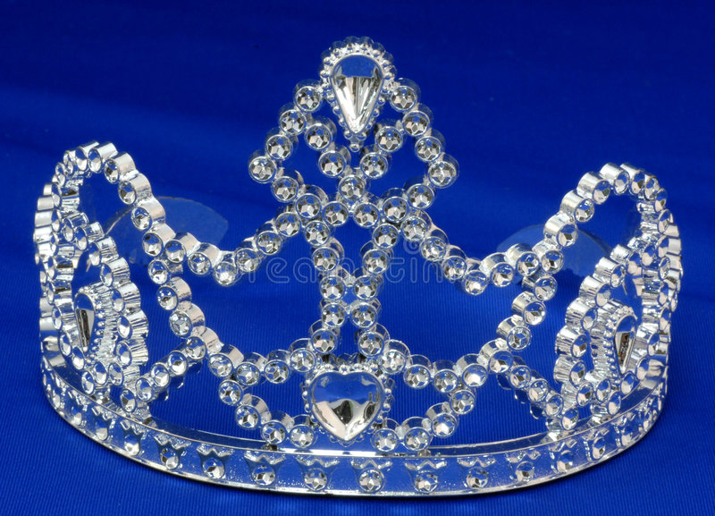 Tiara or crown. Details on blue background royalty free stock photos