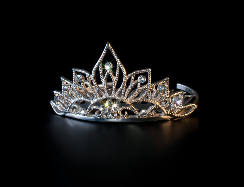 Tiara or diadem with colorful sparkles on black royalty free stock photography