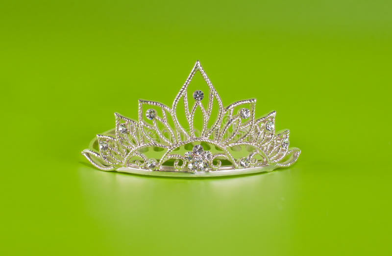 Tiara or diadem with reflection on green stock photo