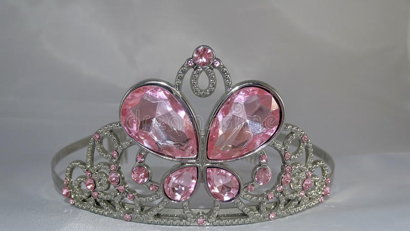 Tiara with pink gems. Tiara with butterfly design. Pink gems and diamond accents stock images