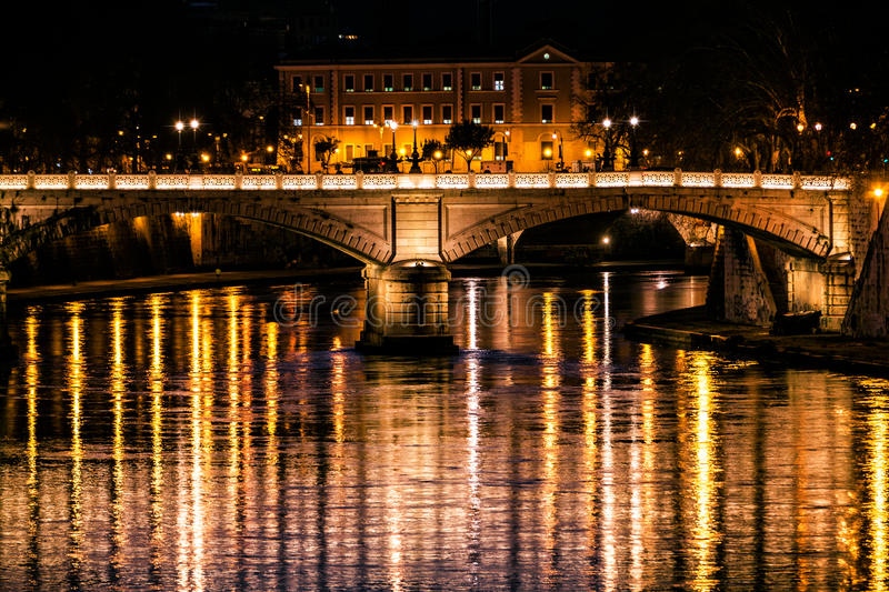 Tiber River, bridge and reflections on water. Night Rome, Italy. Night photography of Rome, Italy. Tiber River, bridge and reflections in the water. Historical royalty free stock photography