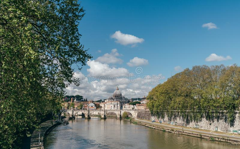 Tiber river cityscape in the Rome city centre with St. Peter`s Basilica Vatican on the background royalty free stock images