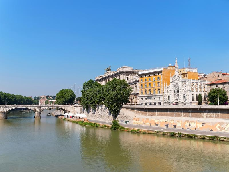 The Tiber River in Rome, Italy with the Church of the Sacred Heart of Jesus in Prati. On the background royalty free stock photography