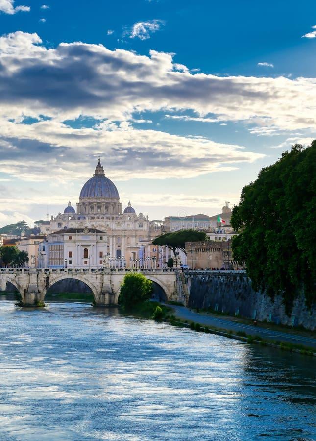 Tiber River towards St. Peter`s Basilica in Rome, Italy. A view along the Tiber River towards St. Peter`s Basilica in Rome, Italy stock photo