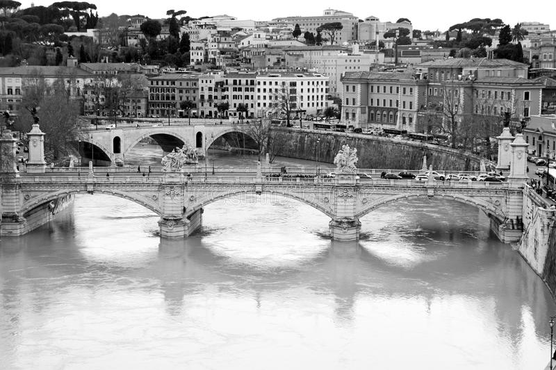 Tiber river. Vittorio Emanuele bridge II. Monochrome photography. Rome, Italy. Ponte Vittorio Emanuele II is a bridge in Rome constructed to designs of 1886 royalty free stock photo