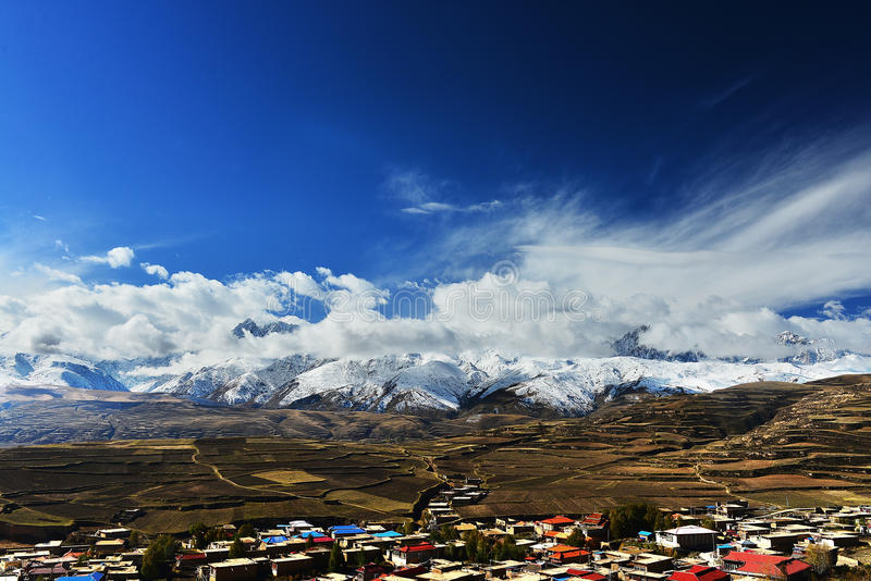 Tibet flag flying in front of the snow-capped mountains royalty free stock image