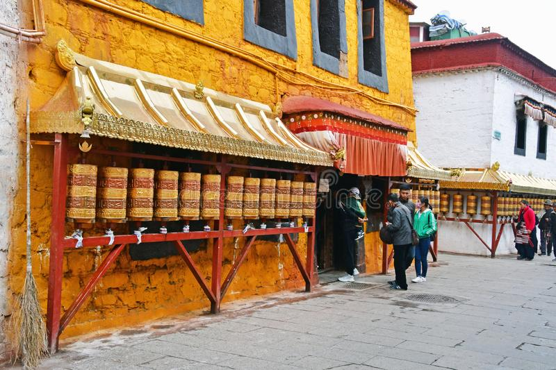 Tibet, Lhasa, China, June, 02, 2018. People coming to one of the small ancient Buddhist monasteries in Lhasa on Barkor street not. Tibet, Lhasa, China. People stock photography