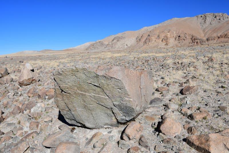 Tibet, rocky shore of lake Tere Tashi Namzo in sunny day royalty free stock image