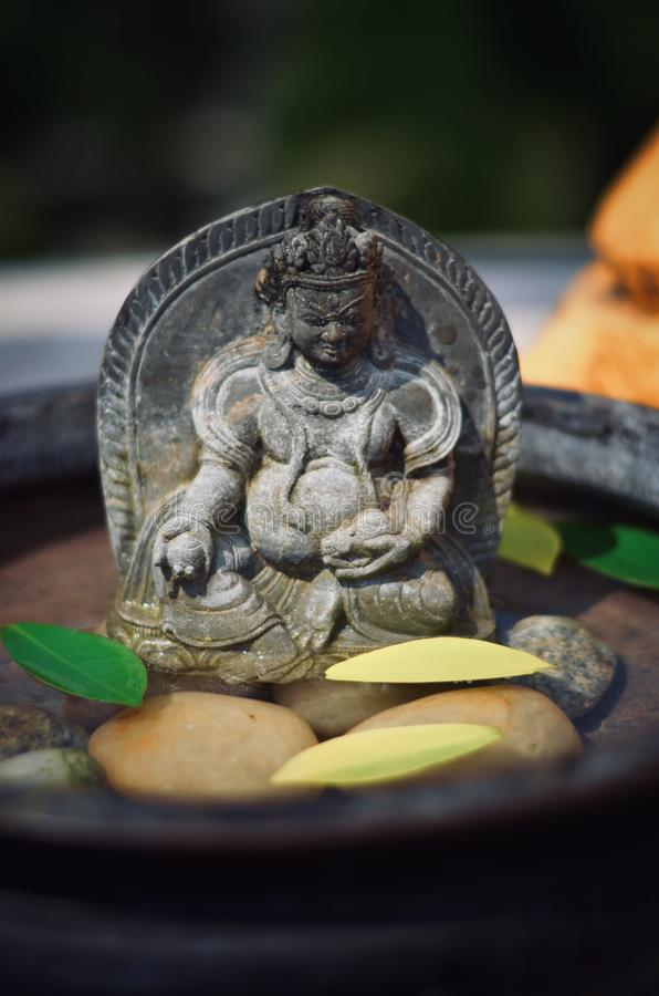 Tibet statuary in the water stock photos