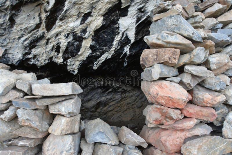 Tibet. Stoned entrance to small cave on the shore of Rakshas Tal lake.  stock photos