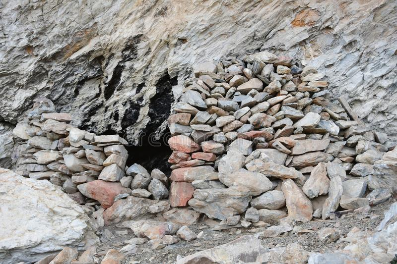 Tibet. Stoned entrance to small cave on the shore of Rakshas Tal lake. Tibet, stoned entrance to small cave on the shore of Rakshas Tal lake royalty free stock photography