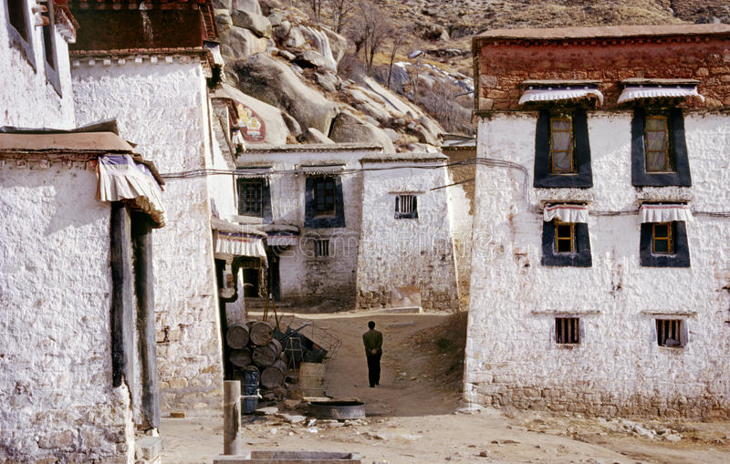 Tibet Temple. A lone figure walks between old buildings in the Buddhist Drepung Monastery, Tibet royalty free stock photos