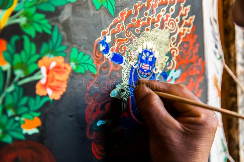 Tibetaanse Thangka die schilderen: De Fusie van een Kunst en een Cultuur stock afbeeldingen