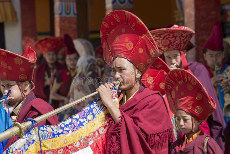 Tibetan Buddhist lamas perform a ritual dance in the monastery of Lamayuru, Ladakh, India. LAMAYURU, INDIA - JUNE 14, 2015: An unidentified buddhist lamas during stock images