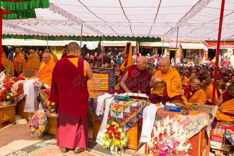 Tibetan Buddhist monks near stupa Boudhanath during festive Puja. KHATMANDU, NEPAL - DEC 17: Unidentified tibetan Buddhist monks near stupa Boudhanath during stock image