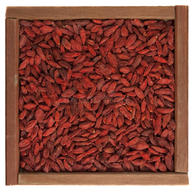 Tibetan goji berries (wolfberry) in wooden box royalty free stock photos