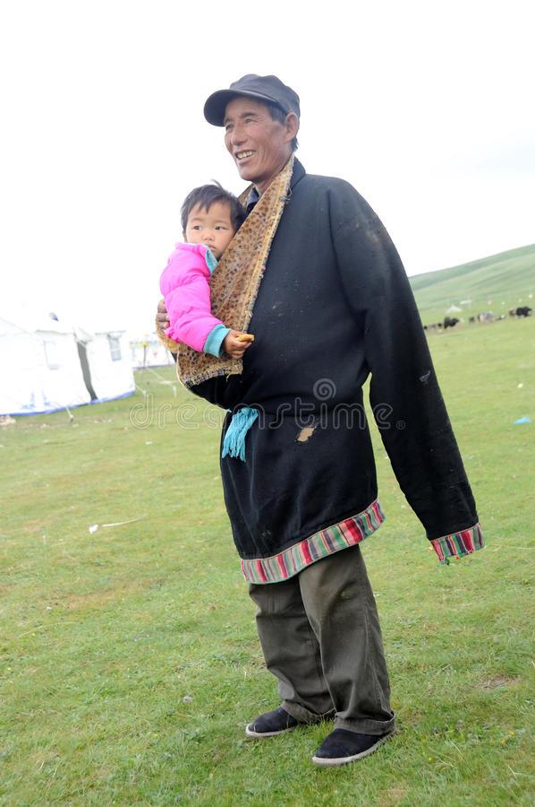 Download Tibetan grandpa and baby editorial stock image. Image of elder - 26010974