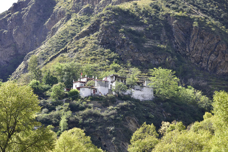 Tibetan houses built on the cliff close-up stock photo