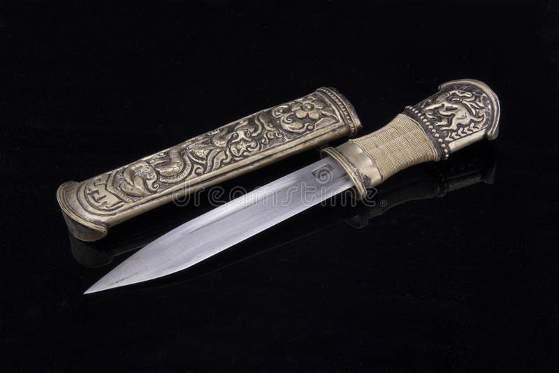 Tibetan knives. Beautifully carved Tibetan knives, in the black background royalty free stock photos