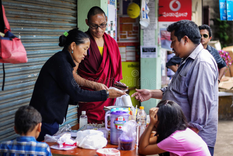 A Tibetan lady selling food at the Street of Tibetan settelment Kushal Nagar, Coorg. royalty free stock image