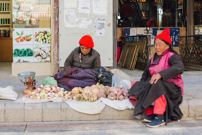 Tibetan market in Leh, Ladakh. Tibetan people selling fruit and vegetable on street market in Ladakh, Jammu and Kashmir, India. LEH, INDIA - April 19 2019 stock images