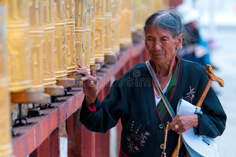 Tibetan pilgrim circles the Potala palace royalty free stock photos