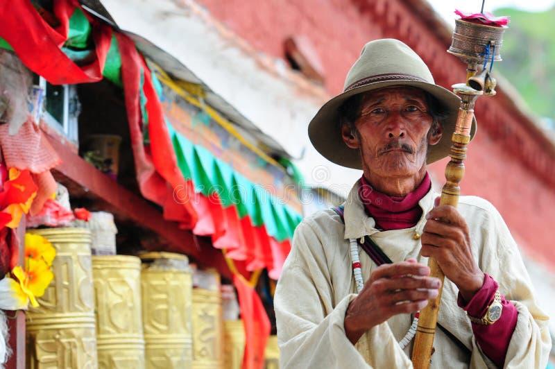 Tibetan pilgrim circles the Potala palace royalty free stock image